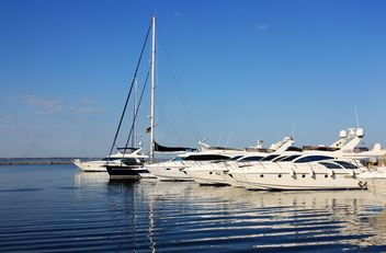 white yachts on a blue sea - image #333261 gratis