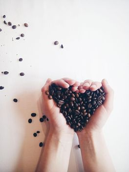 Coffee beans in hands - image #337891 gratis