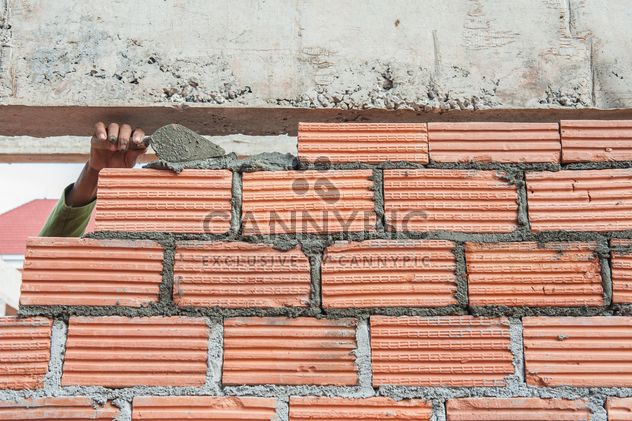 Construction worker laying bricks - Free image #338251