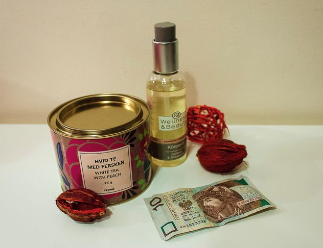 Tea, body oil and banknote - Free image #339211