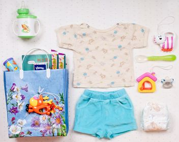 Baby's clothes and things on white background - image gratuit #342901