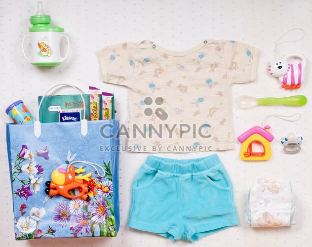 Baby's clothes and things on white background - Free image #342901