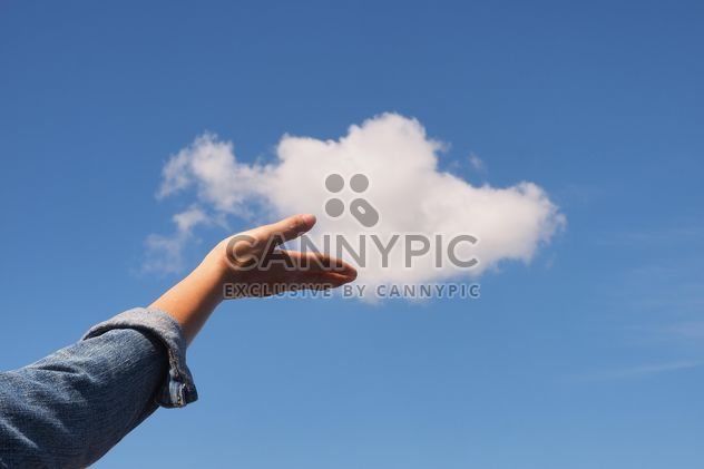 Woman hand with blue sky and white cloud - Free image #344221