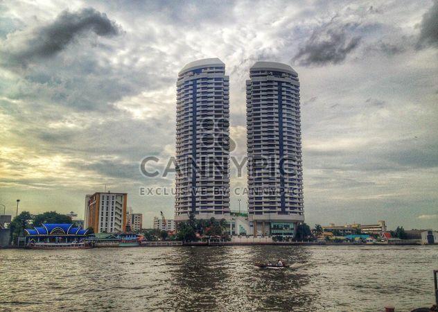 Twin buildings on riverside of Chao Phaya River, Bangkok, Thailand - Free image #346221