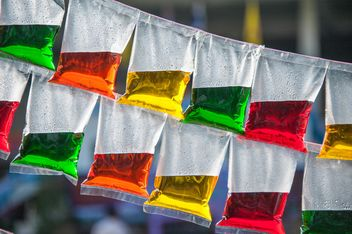 Colored water in plastic bags - image #347231 gratis