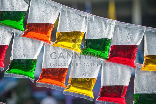 Colored water in plastic bags - Free image #347231