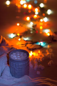 Cup of cocoa with marshmallows in light of garlands - Free image #347951