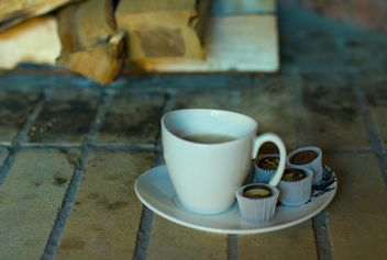 Cup of tea and chocolate candies - бесплатный image #347961