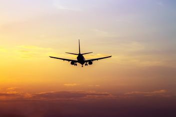 Airplane landing at sunset - Kostenloses image #350271