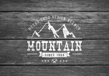Mountain Logo on Wooden Background - Free vector #351431
