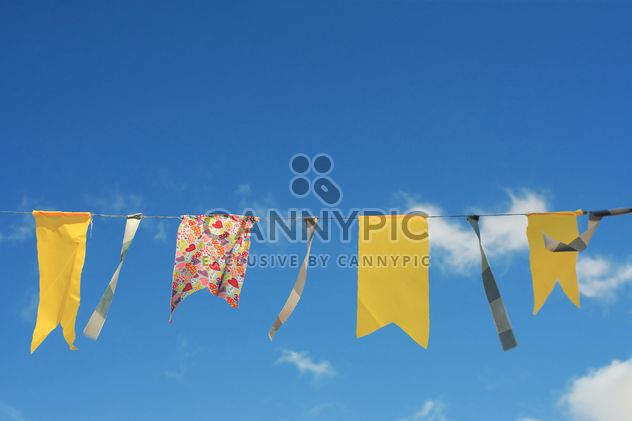 Yellow flags hanging on rope - Free image #359151