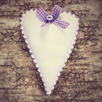 Decorated heart on wooden background. - image gratuit #373551