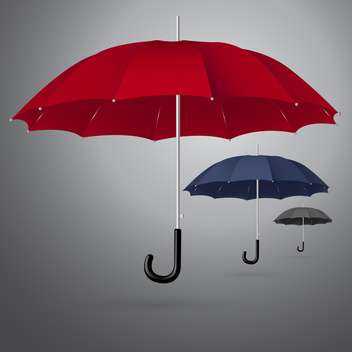 Vector set of three different sized umbrellas on gray background - vector gratuit #129871