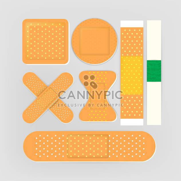 Adhesive bandages set on grey background - Free vector #131851