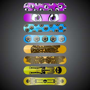Vector snowboards with different design on black background - vector gratuit #132201