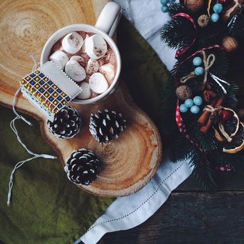 Marshmallows in the cup of cocoa drink and decorations - Free image #136291
