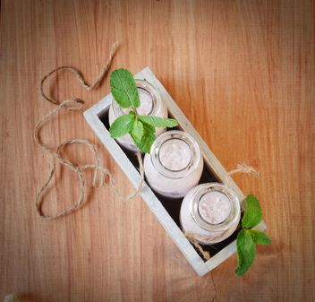 Milk and mint on wooden background - image #136661 gratis