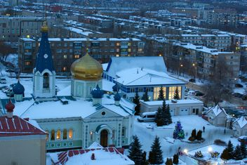 Aerial view on church and houses in winter town - image #182631 gratis