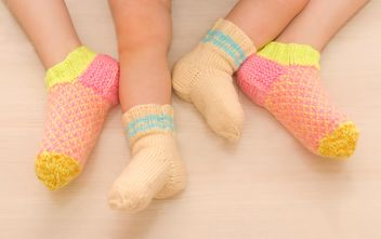 Children in warm socks, two sisters - image #182641 gratis