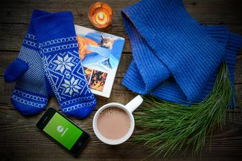 Book, coffee, warm woolen clothes and candle on the wooden table - image #182791 gratis