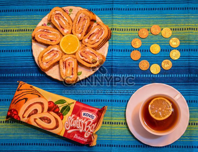 Sweet rolls, cup of tea and coins - Free image #182821