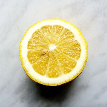 Half of lemon on a gray background - бесплатный image #183221