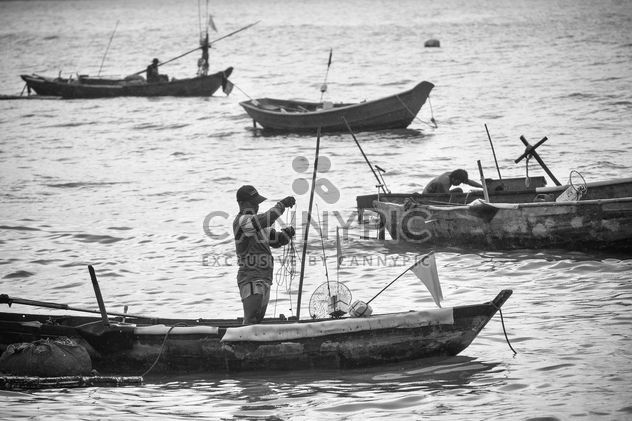 Fishermen in boats - Free image #183461