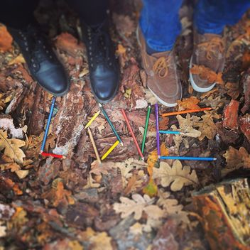 Couple of feet near word Love made of pencils on fallen leaves, #autumncity - image gratuit #183651