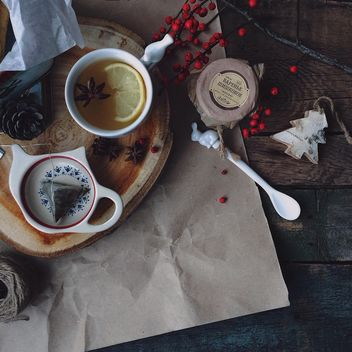 Cup of tea, jam and winter decorations - бесплатный image #183821