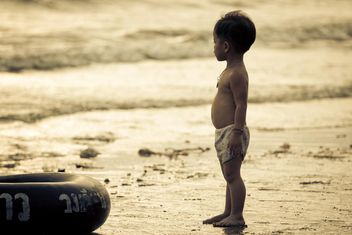 Small Asian boy on seashore at sunset - Free image #183851