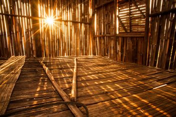 Sunlight pierces into bamboo hut - image #184281 gratis