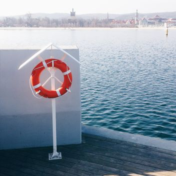 Lifebuoy on pier - Free image #184631
