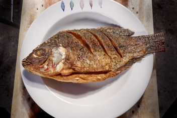 Fried fish on plate - Free image #186071