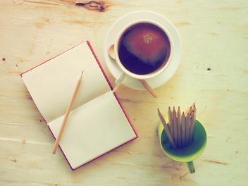 Cup of coffee and notebook - image #186911 gratis