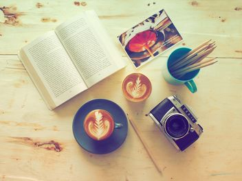 Coffee, old camera and book on wooden background - image #186951 gratis