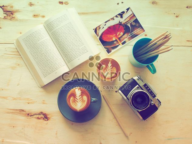 Coffee, old camera and book on wooden background - image gratuit #186951