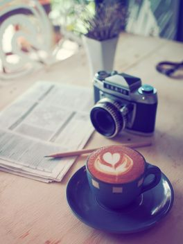 Cup of latte, retro camera and newspaper - бесплатный image #187001