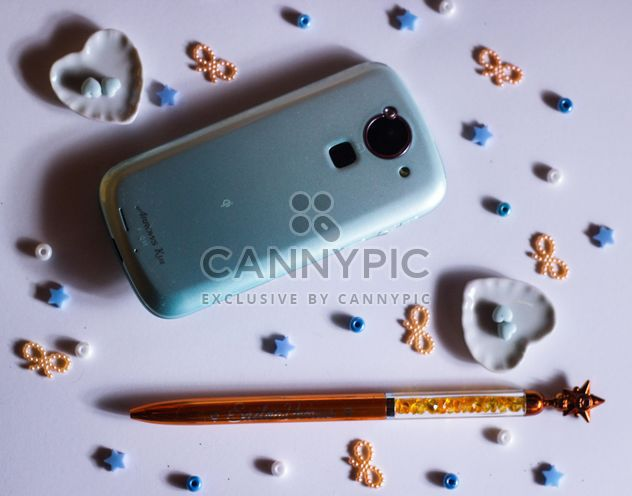 blue smartphone with little hearts and and bows - image gratuit #187241