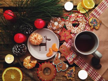 composition with Christmas cookies candles and tangerines - image #198851 gratis