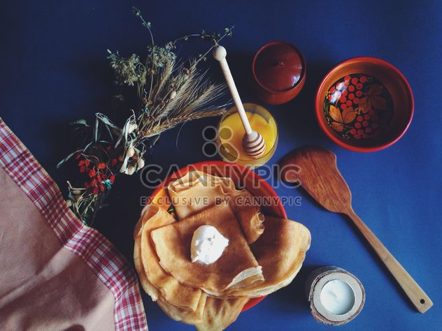Pancakes with sour cream and honey on blue background - Free image #198891
