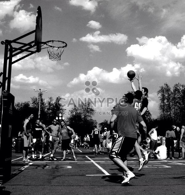Men playing street basketball - Free image #200681