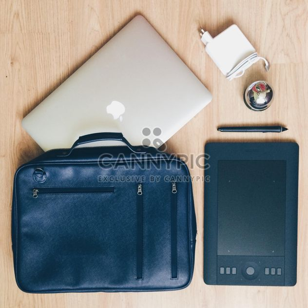 Macbook, tablet Pc and designer's bag on wooden background - Free image #271731