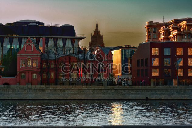 Architecture on waterfront of river at sunset - Free image #271981