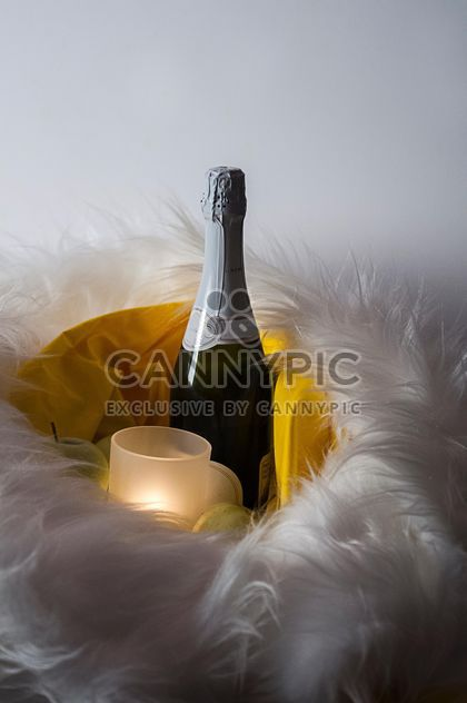 Bottle of Champagne and candle in fur - Free image #272531