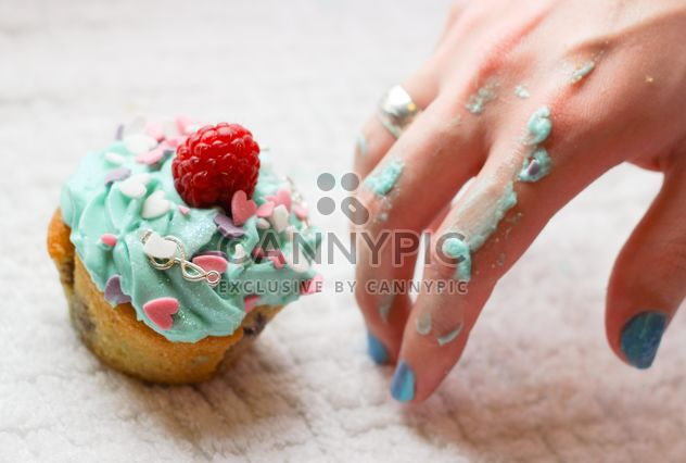 Hand in cream from cupcake - Free image #273741