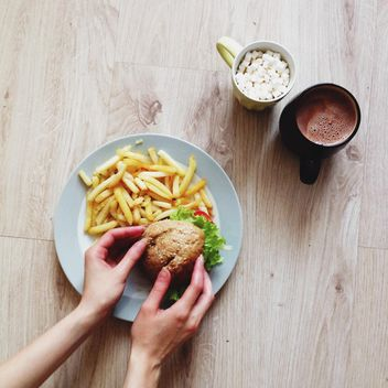 French fries with burger and cup of cocoa for breakfast - Free image #273821