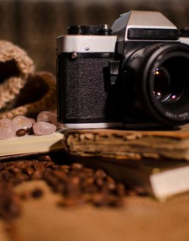Old camera, books, runes and coffee beans - image #275321 gratis