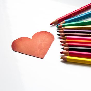 Red heart shaped card and pencils - image gratuit #301361