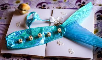 Decorative mermaid tail on a note book - Free image #302521