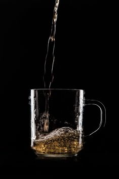 Glass cup on black background - image gratuit #303221